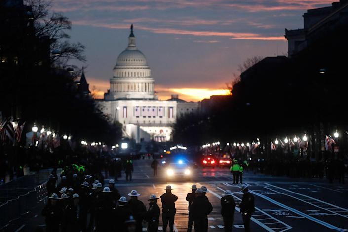 <p>Security personnel gather on Pennsylvania Avenue before the presidential inauguration of President-elect Donald Trump, Friday, Jan. 20, 2017, in Washington. (Photo: John Minchillo/AP) </p>
