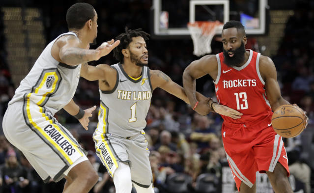 "<a class=""link rapid-noclick-resp"" href=""/nba/teams/hou/"" data-ylk=""slk:Houston Rockets"">Houston Rockets</a>' James Harden, right, drives past <a class=""link rapid-noclick-resp"" href=""/nba/teams/cle/"" data-ylk=""slk:Cleveland Cavaliers"">Cleveland Cavaliers</a>' <a class=""link rapid-noclick-resp"" href=""/nba/players/3934/"" data-ylk=""slk:Channing Frye"">Channing Frye</a>, left, and Derrick Rose in the second half of an NBA basketball game, Saturday, Feb. 3, 2018, in Cleveland. The Rockets won 120-88. (AP Photo/Tony Dejak)"