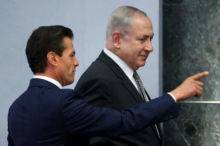 Israeli Prime Minister Benjamin Netanyahu speaks with Mexico's President Enrique Pena Nieto during an addresses to the media at Los Pinos presidential residence in Mexico City, Mexico, September 14, 2017. REUTERS/Edgard Garrido