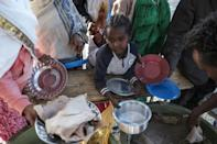 A displaced child from western Tigray waits in line for a plate of food in Mekele, the region's capital