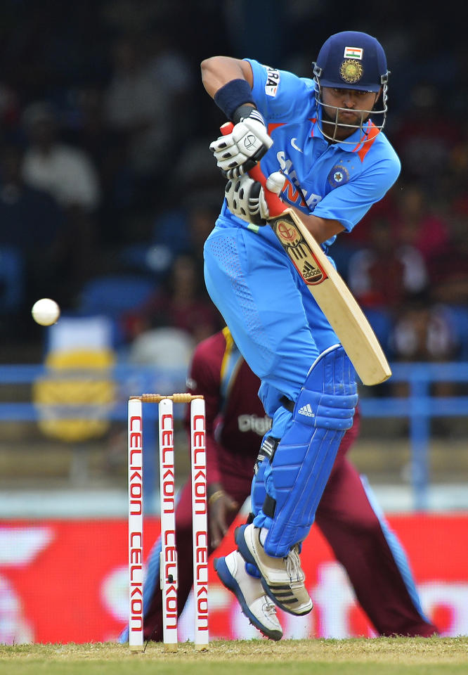 Indian cricketer Suresh Raina plays a shot during the fourth match of the Tri-Nation series between India and West Indies at the Queen's Park Oval in Port of Spain on July 5, 2013. West Indies won the toss and elected to field. AFP PHOTO/Jewel Samad        (Photo credit should read JEWEL SAMAD/AFP/Getty Images)