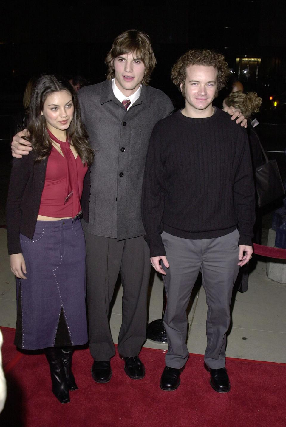 Mila Kunis, Ashton Kutcher, and Danny Masterson attend an event together in 2000. (Photo: SGranitz/WireImage)