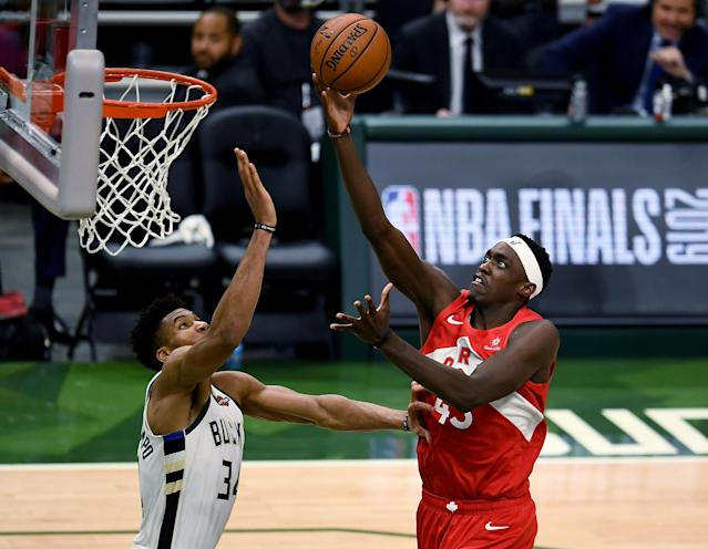 Pascal Siakam #43 of the Toronto Raptors attempts a shot while being guarded by Giannis Antetokounmpo #34 of the Milwaukee Bucks at the Fiserv Forum on May 23, 2019 in Milwaukee, Wisconsin.