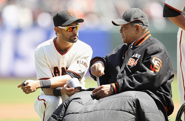 SAN FRANCISCO, CA - APRIL 13: Former San Francisco Giants Willie Mays speaks to Angel Pagan #16 of the San Francisco Giants during a pregame ceremony before their game against the Pittsburgh Pirates at AT&T Park on April 13, 2012 in San Francisco, California. (Photo by Ezra Shaw/Getty Images)