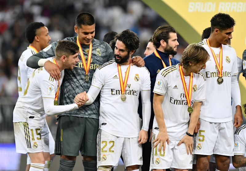 Soccer Football - Spanish Super Cup Final - Real Madrid v Atletico Madrid - King Abdullah Sports City, Jeddah, Saudi Arabia - January 12, 2020 Real Madrid's Isco, Federico Valverde and Alphonse Areola celebrate winning the Super Cup REUTERS/Waleed Ali