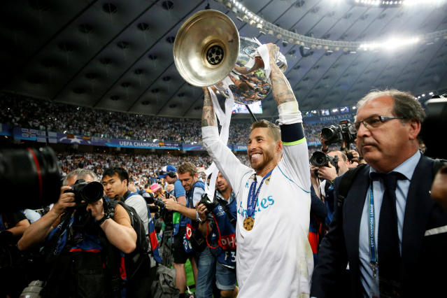 Soccer Football - Champions League Final - Real Madrid v Liverpool - NSC Olympic Stadium, Kiev, Ukraine - May 26, 2018 Real Madrid's Sergio Ramos celebrates with the trophy after winning the Champions League REUTERS/Gleb Garanich TPX IMAGES OF THE DAY