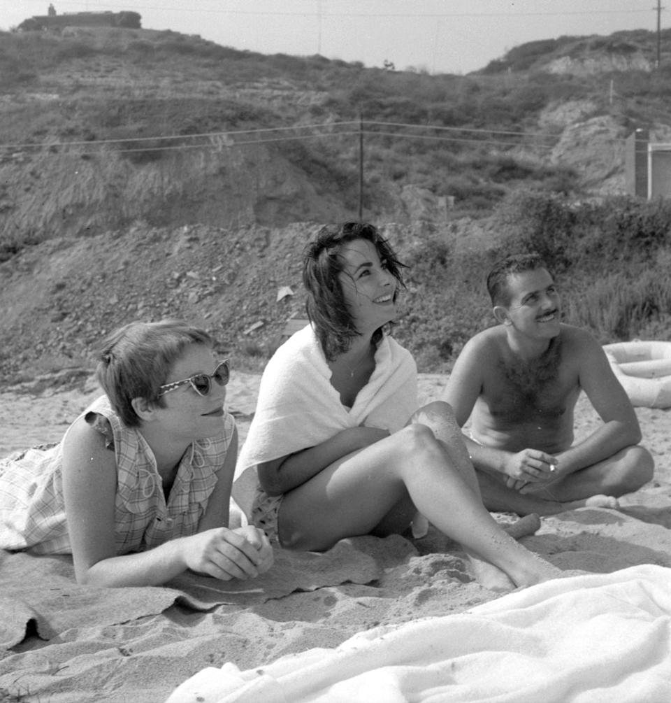 <p>Here, a candid photo shows Elizabeth enjoying a day at the beach with friends. </p>