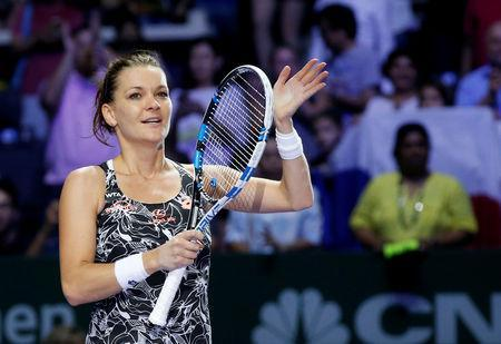 FILE PHOTO: Tennis - Singapore WTA Finals Round Robin Singles - Singapore Indoor Stadium, Singapore - 28/10/2016 - Agnieszka Radwanska of Poland celebrates after defeating Karolina Pliskova of the Czech Republic REUTERS/Edgar Su/File Photo