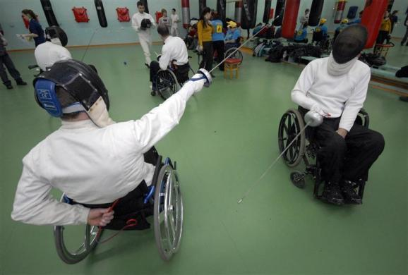 Disabled men take part in a wheelchair fencing training session in Russia's far eastern city of Vladivostok, Russia March 11, 2011. The Kovcheg (Ark) organization, which supports disabled people, and local authorities held a series of sporting events to popularize Paralympic sports.