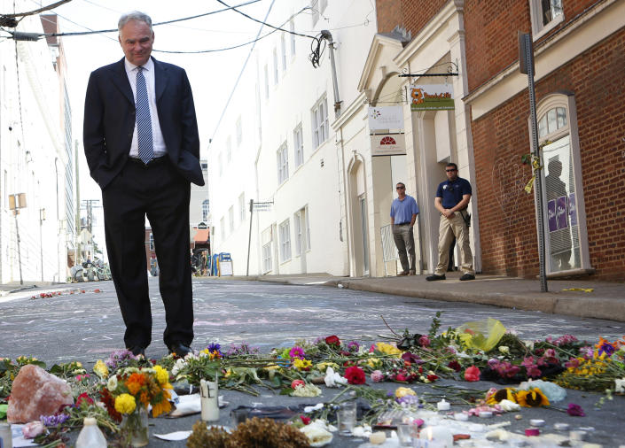 Sen. Tim Kaine visits a makeshift memorial Wednesday, Aug. 16, 2017, where Heather Heyer was killed Saturday when a car rammed into a crowd of people protesting a white nationalist rally Charlottesville, Va. (Photo: Julia Rendleman/AP)