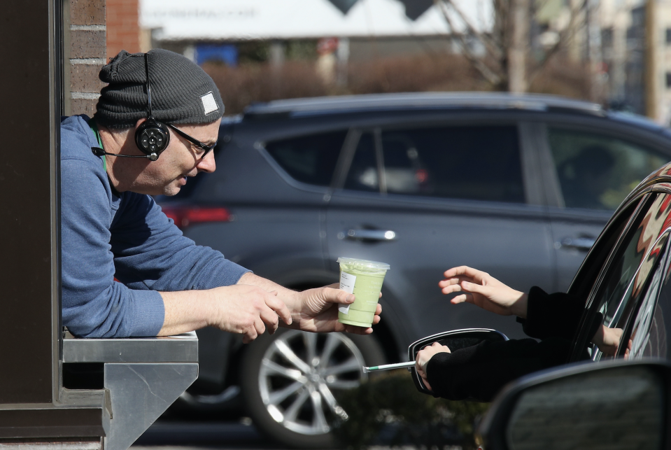 Customers of a Starbucks use the drive up window on March 18, 2020 in Hicksville, New York. (Photo: Bruce Bennett/Getty Images)