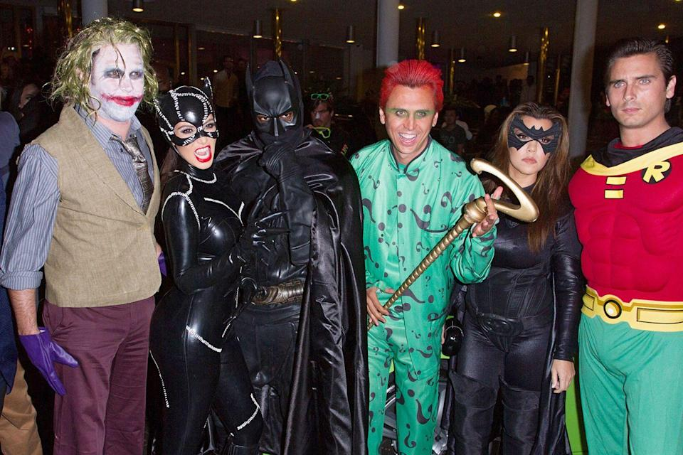 <p>Alright, so this one counts as a full-on family (versus couples) costume. In 2012, the Kardashians went for full-on coordinated Halloween outfits: Kim Kardashian, Kanye West, Jonathan Cheban, Kourtney Kardashian, and Scott Disick went as characters from <em>Batman</em> for Kim's Halloween party in Miami, Florida.</p>