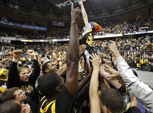 Virginia Commonwealth players and fans celebrate winning the Colonial Athletic Association Championship NCAA college basketball game at the Coliseum in Richmond, Va., Monday, March 5, 2012. VCU won the game 59-56. (AP Photo/Steve Helber)