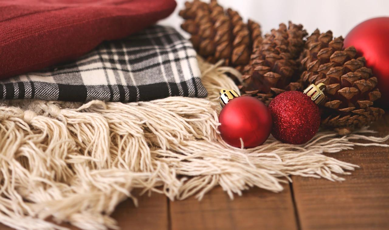 <p>There is no rule that says you have to decorate. So don't if you don't feel like it. Or maybe throw a festive blanket across the couch - no muss, no fuss, and done when you feel like being done. </p>