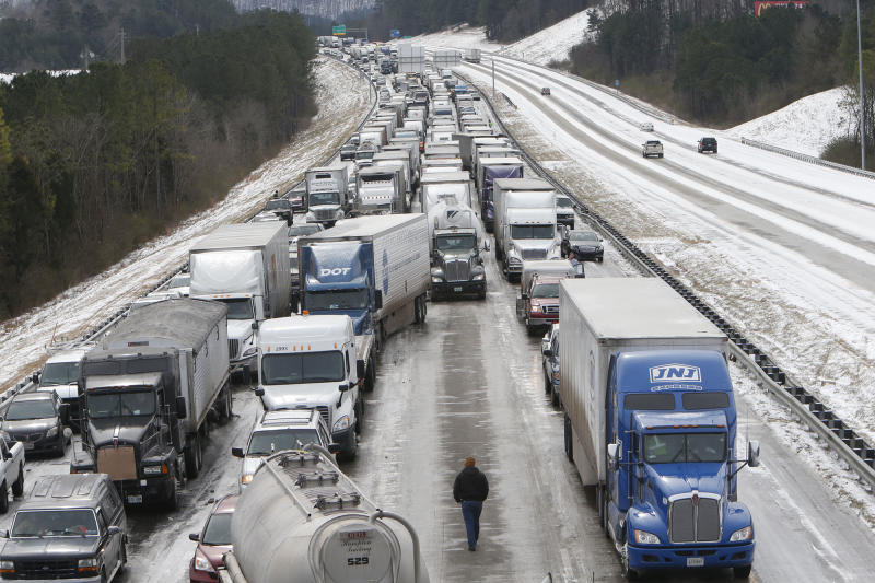 Traffic is at a standstill on Interstate 65 northbound as officials work to clear abandoned vehicles Wednesday, Jan. 29, 2014 in Hoover, Ala. Overnight, the South saw fatal crashes and hundreds of fender-benders. Jackknifed 18-wheelers littered Interstate 65 in central Alabama. Ice shut down bridges on Florida's panhandle and the Lake Pontchartrain Causeway, one of the world's longest spans, in Louisiana. Some commuters pleaded for help via cellphones while still holed up in their cars, while others trudged miles home, abandoning their vehicles outright. (AP Photo/Hal Yeager)