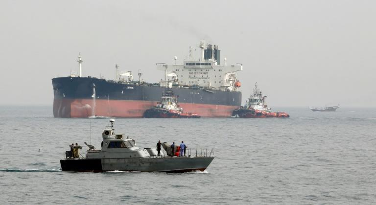 A tanker prepares to dock at an oil facility on the Iranian island of Khark on March 12, 2017