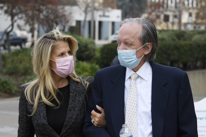 Bill Gross (R), founder of investment company PIMCO, and partner Amy Schwartz arrive for a court hearing in Santa Ana, California, December 7, 2020. - Mark Towfiq and wife Carol Nakahara are suing neighbors Bill Gross and Amy Schwartz over complaints that they played loud music, including the theme to Gilligan's Island, in response to a dispute over an art installation on Gross' property, while Gross filed a cross-complaint against his neighbor. (Photo by Patrick T. Fallon / AFP) (Photo by PATRICK T. FALLON/AFP via Getty Images)