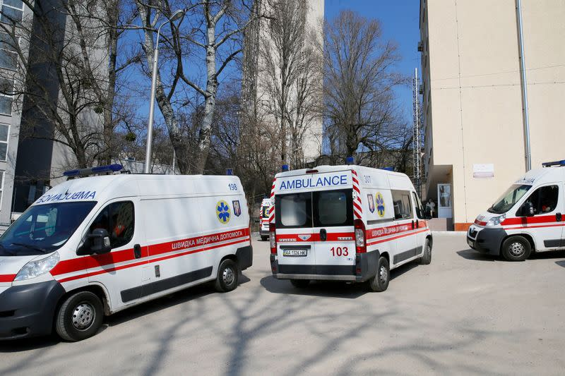 FILE PHOTO: Ambulances with COVID-19 patients wait in the queue at a hospital in Kyiv