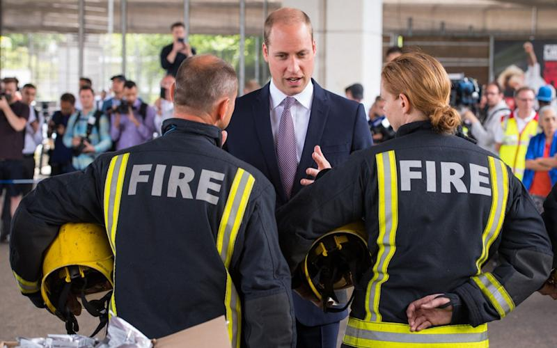 The Duke of Cambridge meets firefighters during a visit to the Westway Sports Centre , which is providing temporary shelter - Credit: Dominic Lipinski/PA