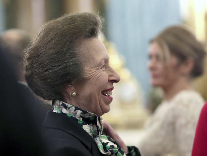FILE - In this Tuesday, Dec. 3, 2019 file photo, Britain's Princess Anne talks to guests during a reception at Buckingham Palace, as NATO leaders gather to mark 70 years of the alliance, in London. The British royal family might be known for smiling and waving in fancy outfits, but they work just as hard as anyone else…right? According to official records, prominent members of the royal family worked on average 84.5 days, a third of the 253 working days in 2019. The Queen's only daughter, Princess Anne, was the hardest working royal for the second year in a row, working a total of 167 days. (Yui Mok/Pool Photo via AP, File)