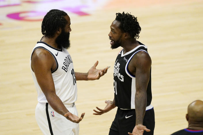 Brooklyn Nets guard James Harden, left, talks with Los Angeles Clippers guard Patrick Beverley after a confrontation in the first half of an NBA basketball game Sunday, Feb. 21, 2021, in Los Angeles. (AP Photo/Mark J. Terrill)