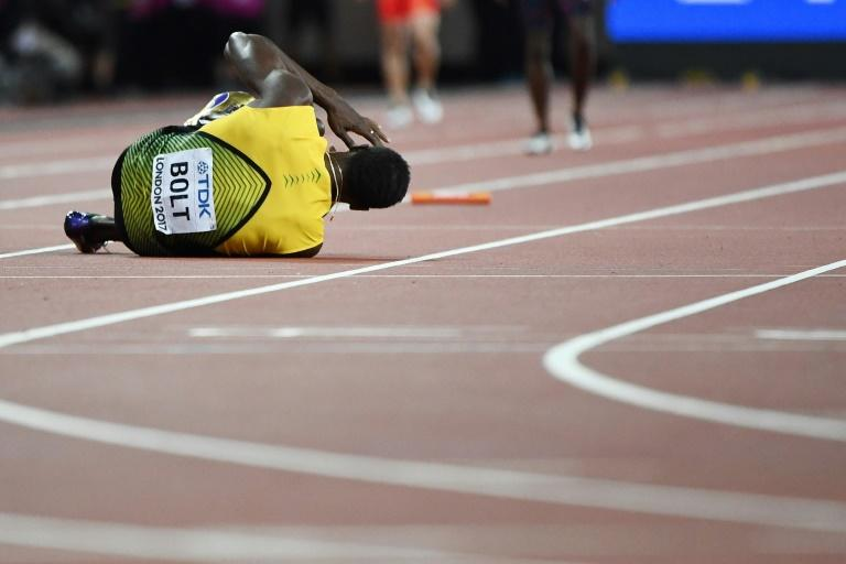 Jamaica's Usain Bolt goes down after pulling up injured in the final of the men's 4x100m relay at the 2017 IAAF World Championships at the London Stadium in London on August 12, 2017