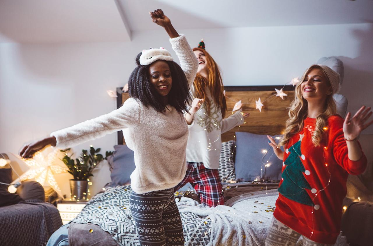 """<p>Giving gifts is a traditional part of the holidays. Make it a Secret Santa with a small budget so no one goes broke, and encourage your friends to wear their favorite <a href=""""https://www.popsugar.com/family/Best-Christmas-Pajamas-Women-45266372"""" class=""""ga-track"""" data-ga-category=""""Related"""" data-ga-label=""""http://www.popsugar.com/family/Best-Christmas-Pajamas-Women-45266372"""" data-ga-action=""""In-Line Links"""">holiday pajamas</a> to make it more casual and fun.</p>"""