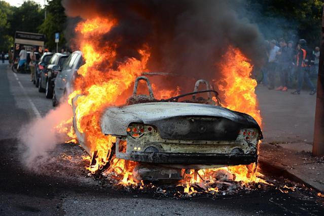 <p>A car burns during a protest against the upcoming G20 summit in Hamburg, Germany, July 6, 2017. (Photo: Christophe Gateau/dpa via AP) </p>