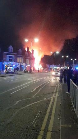 Flames leap into the sky from the site of an explosion in Leicester, Britain, February 25, 2018 in this still image taken from a video obtained from social media. FACEBOOK/GRAEME HUDSON/via REUTERS