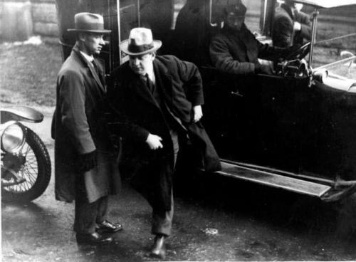 Undated photo of Michael Collins emerging from a vehicle