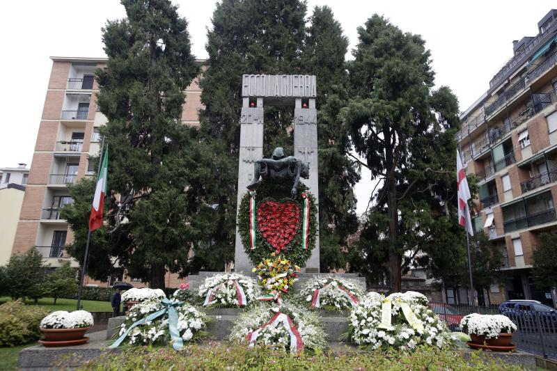 Flowers lie in front of a bronze ossuary monument entitled 'Ecco La Guerra', (Here is War) dedicated to the 'Little Martyrs of Gorla', in memory of a World War II bombing raid on Oct. 20 1944 is pictured in Milan, Italy, Sunday, Oct. 20, 2019. Milan's mayor Giuseppe Sala, following a Mass Sunday for the 75th anniversary of the raid, asked U.S. authorities to apologize for a World War II bombing raid that killed 184 elementary school children. (AP Photo/Luca Bruno)