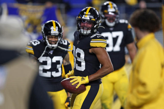 Pittsburgh Steelers free safety Minkah Fitzpatrick (39) celebrates his touchdown after recovering a fumble by Los Angeles Rams quarterback Jared Goff during the first half of an NFL football game in Pittsburgh, Sunday, Nov. 10, 2019. (AP Photo/Keith Srakocic)