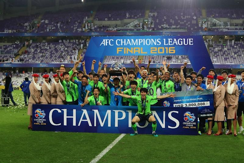 Jeonbuk players celebrate following their AFC Champions League final against between UAE's Al-Ain at the Hazza bin Zayed Stadium in Al-Ain on November 26, 2016