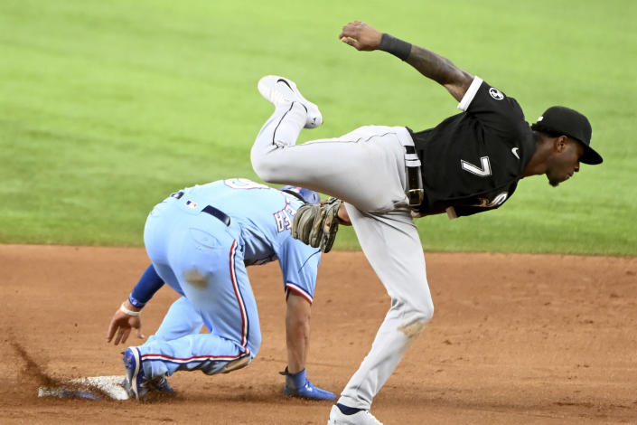 Texas Rangers' Isiah Kiner-Falefa (9) steals second base in front of a tag by Chicago White Sox shortstop Tim Anderson (7) in the fifth inning during a baseball game in Arlington Texas, Sunday, Sept. 19, 2021. (AP Photo/Matt Strasen)