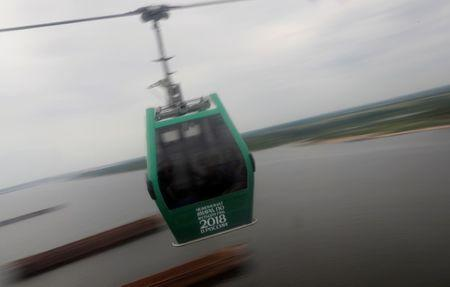 Visitors take a cable car ride over the River Volga between Bor and Nizhny Novgorod, Russia July 1, 2018. REUTERS/Darren Staples