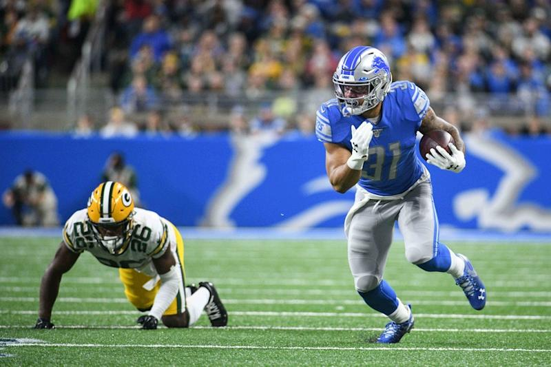 Ty Johnson running in a Lions uniform