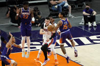 Miami Heat guard Tyler Herro passes as Phoenix Suns guard Cameron Payne (15) defends during the first half of an NBA basketball game, Tuesday, April 13, 2021, in Phoenix. (AP Photo/Matt York)