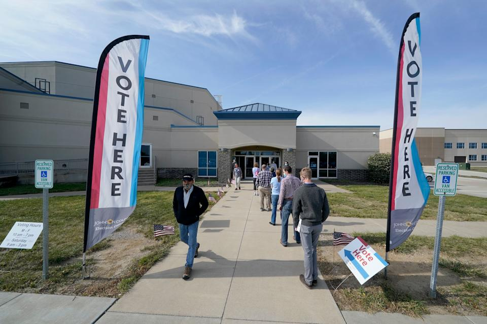 People wait to cast their ballot on the first day of early voting at an advance polling location Saturday, Oct. 17, in Overland Park, Kansas. (Photo: AP Photo/Charlie Riedel)