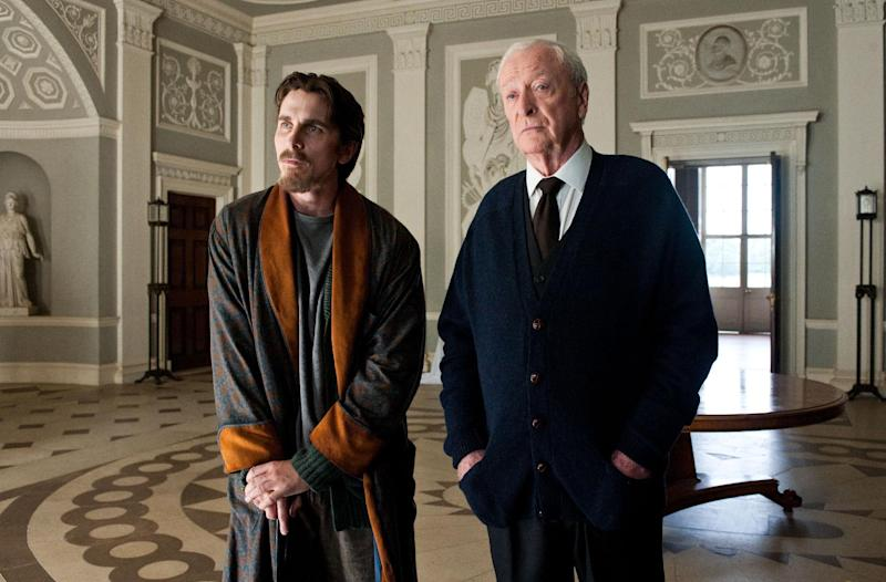 """FILE - This undated image released by Warner Bros. Pictures shows Christian Bale as Bruce Wayne, left, and Michael Caine as Alfred in a scene from the """"The Dark Knight Rises."""" Studio executives expected their biggest summer ever this year. What they got were two colossal hits (""""The Avengers"""" and """"The Dark Knight Rises""""), a solid slate of back-up blockbusters (among them """"The Amazing Spider-Man"""" and """"Ted"""") and plenty of duds (""""Battleship,"""" """"Total Recall"""") that just didn't deliver. (AP Photo/Warner Bros. Pictures, Ron Phillips, File)"""