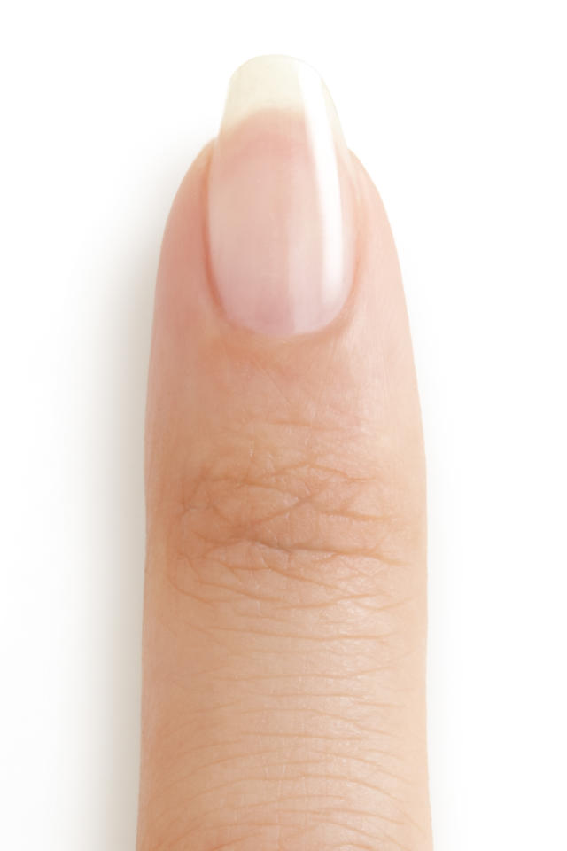 "<p>To start, apply a coat of <a rel=""nofollow"" href=""http://www.essie.com/Nail-Care/base-coats/first-base.aspx"">First Base</a> base coat. This will help to smooth the nail and help bond the polish to the surface. (Photo: Essie) </p>"