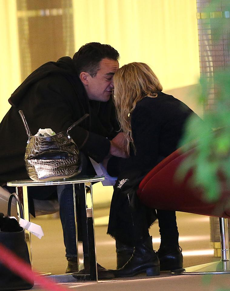 Exclusive... 50984052 Actress and fashionista Mary-Kate Olsen departing on a flight at Roissy airport in Paris, France with her much older French boyfriend Olivier Sarkozy on January 6th, 2013. The happy couple aren't afraid to show some PDA while they wait for their flight. No Internet Use Without Prior Agreement  FameFlynet, Inc - Beverly Hills, CA, USA -  1 (818) 307-4813 RESTRICTIONS APPLY: USA/AUSTRALIA ONLY