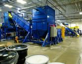 E-waste recycling machinery at an Apple recycling facility in Austin