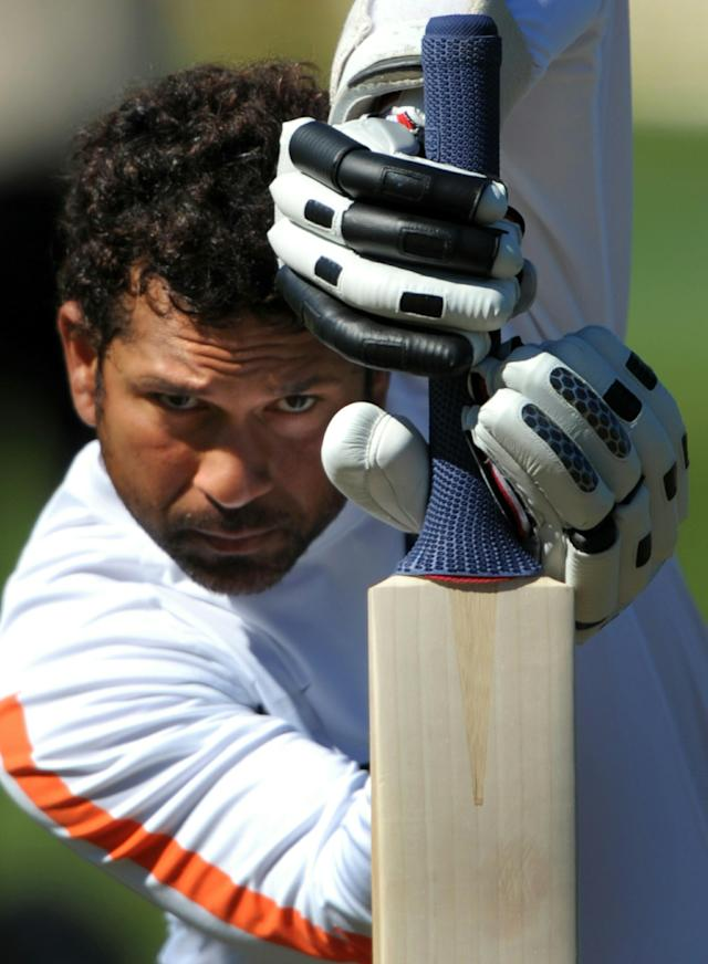 TO GO WITH AFP STORY BY KULDIP LAL Cricket-WC2011-IND-India-Tendulkar (FILES) This file photo taken on April 2, 2009 shows Indian cricketer Sachin Tendulkar practising his batting skills before the final Test between New Zealand and India, at the Basin Reserve stadium in Wellington. A billion hearts will beat for Sachin Tendulkar as he attemps to win the World Cup for India in his record-equalling sixth appearance in cricket's showpiece event. AFP PHOTO/Dibyangshu SARKAR (Photo credit should read DIBYANGSHU SARKAR/AFP/Getty Images)
