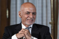 FILE - In this June 25, 2021 file photo, Afghan President Ashraf Ghani is seated after his meeting with President Joe Biden in Washington. The United Arab Emirates and Qatar, a few hours by plane from the Afghan capital, have much in common, despite their sharp political differences. Both have close security partnerships with the United States and both have taken in political fugitives and exiled leaders on the run. Ghani surfaced in Abu Dhabi after the Taliban swept into Kabul on Sunday, Aug. 15, 2021. The Taliban's political leadership for years resided in Qatar. (AP Photo/Alex Brandon, File)