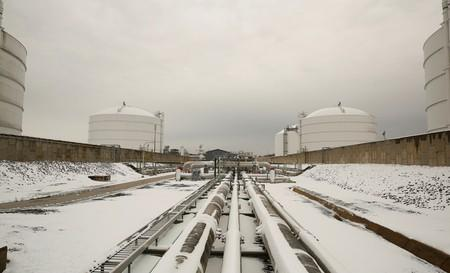 FILE PHOTO: Snow covered transfer lines are seen with storage tanks at the Dominion Cove Point Liquefied Natural Gas terminal in Maryland