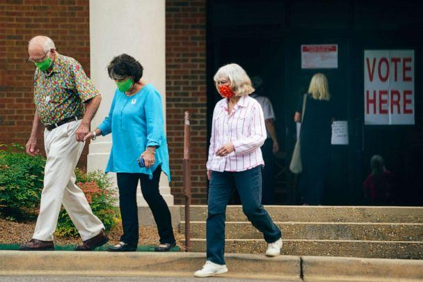 PHOTO: Voters wearing protective masks leave a polling location in Montgomery, Ala., July 14, 2020. (Bloomberg via Getty Images)