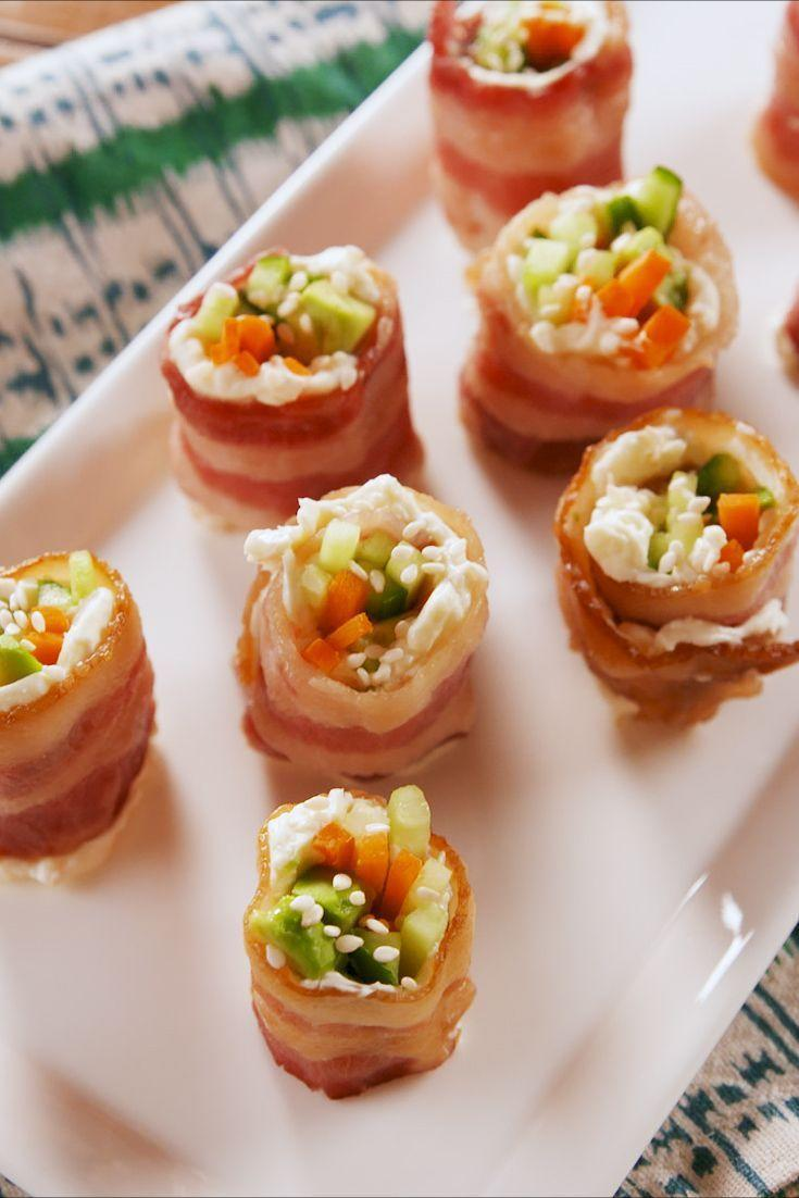 """<p>Being on a keto diet means you have way fewer options for snacking. Never fear! These little guys will satisfy all your snack cravings: They're salty, creamy, and crunchy, but they won't weigh you down.</p><p>Get the <a href=""""https://www.delish.com/uk/cooking/recipes/a31327674/keto-bacon-sushi-recipe/"""" rel=""""nofollow noopener"""" target=""""_blank"""" data-ylk=""""slk:Keto Bacon Sushi"""" class=""""link rapid-noclick-resp"""">Keto Bacon Sushi</a> recipe.</p>"""