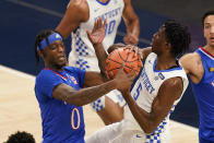 Kentucky's Terrence Clarke (5) is defended by Kansas' Marcus Garrett (0) during the first half of an NCAA college basketball game Tuesday, Dec. 1, 2020, in Indianapolis. (AP Photo/Darron Cummings)