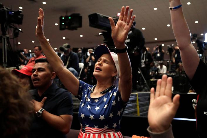 Wanda Albritton of Miami Springs, Florida, raises her arms in prayer at a rally for evangelical supporters at the King Jesus International Ministry church on Jan. 3 in Miami. (Photo: ASSOCIATED PRESS)