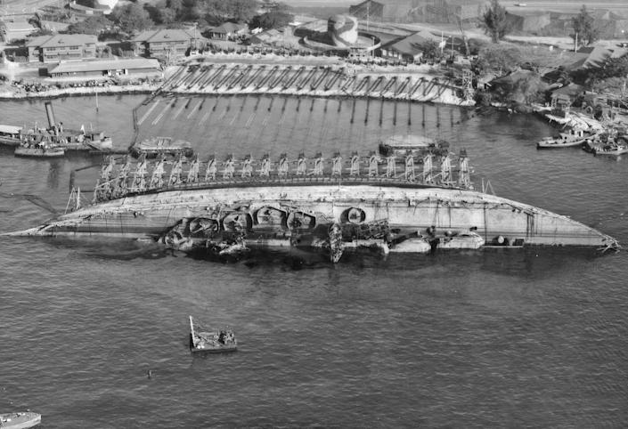 The U.S.S. Oklahoma was the most difficult ship to salvage after the attack on Pearl Harbor. The preparations to right the ship's hull took eight months. | U.S. Navy Photos